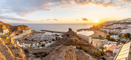 Wall Mural - Amazing landscape with sunset at Puerto Rico harbor and village at Gran Canaria, Spain