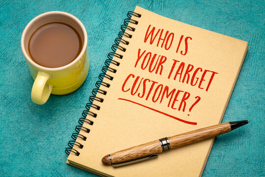 Who is your target customer? Handwriting in a notebook with a cup of coffee. Starting business and marketing concept.