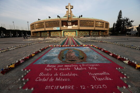 Candles are pictured on behalf of faithful at Basilica of Guadalupe that is temporarily closed to avoid crowds on the traditional day of celebration of the Virgin of Guadalupe