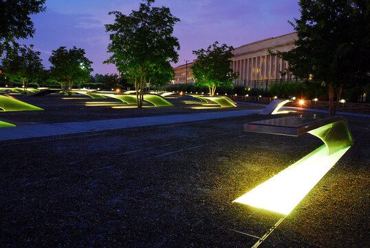 Lighted benches glow at the 9/11 Pentagon Memorial
