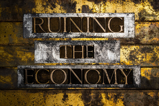 Ruining The Economy text on vintage textured bronze grunge copper and gold background