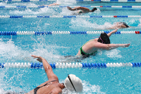 Motion blurred, Women Butterfly swimmers racing in a pool
