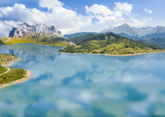 photographic composition of a mountain reflected on a lake