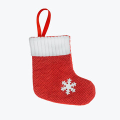 Christmas red sock with white snowflake isolated on white