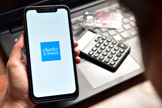New Delhi, India - December 15, 2019: Using Charles Schwab application on smartphone