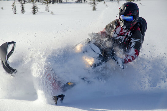 "Backcountry snowmachine rider ""sledder"" in Alaska."