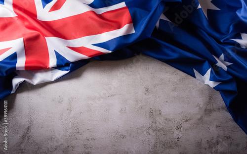 Happy Australia day concept. Australian flag against old stone background. 26 January.