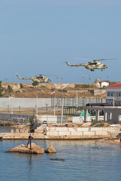 Helicopters Mi-8AMTSh of the Russian Aerospace Forces perform landing at the Konstantinovskaya battery in the city of Sevastopol, Crimea