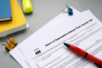 Fototapeta Form 990 Return of Organization Exempt From Income Tax inscription on the sheet. obraz