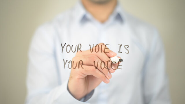 Your Vote is your Voice, man writing on transparent screen