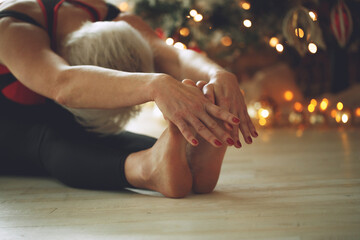 Young woman meditates during yoga class at Christmas. Freedom concept. Calm and relaxation, female happiness. Tinted drawing. High quality photo.