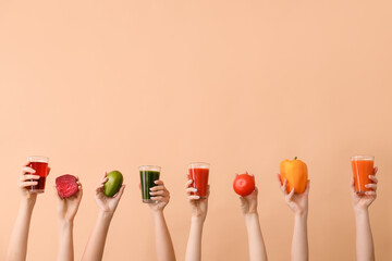 Many hands with glasses of vegetable juices on color background