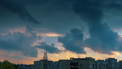 Fotobehang - Epic beautiful storm clouds passing over city skyline background at sunset. Part 2 of 2. Timelapse, 4K UHD.