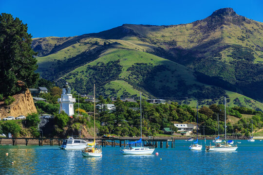 French Bay, Akaroa, New Zealand. The historic lighthouse on the left of the photo first operated in 1880
