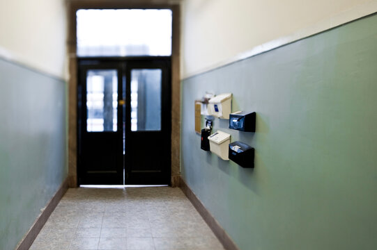 Mail boxes in apartment building corridor.