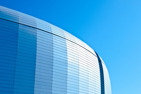 Curved roof of a metal modern building.