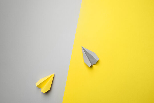 Trend photography on theme of new color of year 2021: Ultimate Gray and Illuminating. yellow and gray planes on the background with copy space