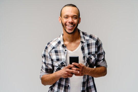 Portrait of a young african american man holding mobile cell phone