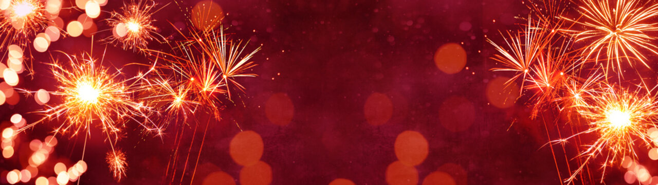 Silvester background panorama banner long - Firework on red texture with bokeh Lights and space for text