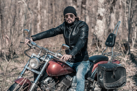 Biker portrait. Photo with a motorcycle