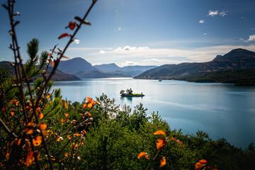 Lac de Serre Ponçon, savine the lake and its superb autumn colors - Lake in the mountains in...