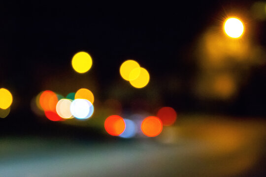 traffic light on the night streets. urban background with bokeh effect