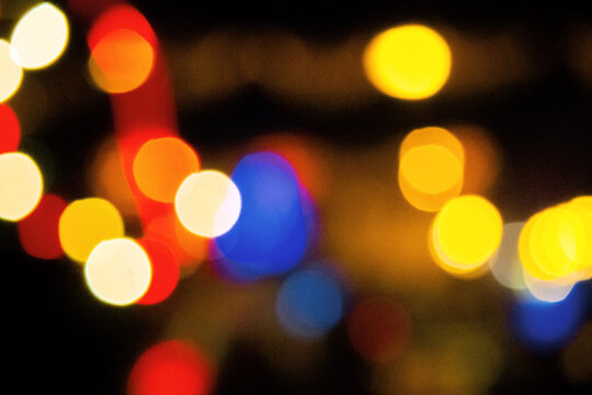 winter holidays background. garlands on the street with bokeh effect