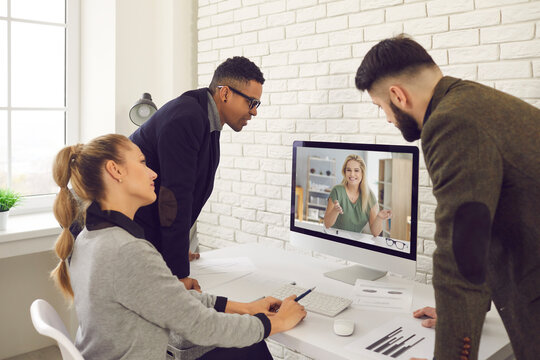 Group of diverse business people video calling coworker or communicating with online mentor