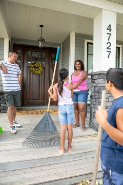 Parents giving allowance to children for gardening chores