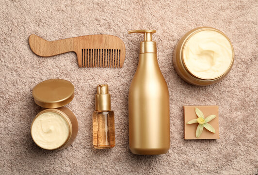 Flat lay composition with hair cosmetic products on towel