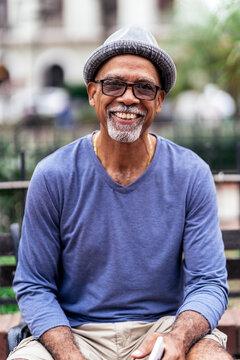 Senior black man smiling at camera.