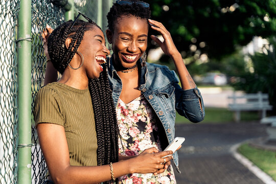 Young afro women using smartphone