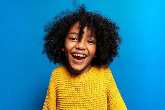 Black kid in studio laughing.