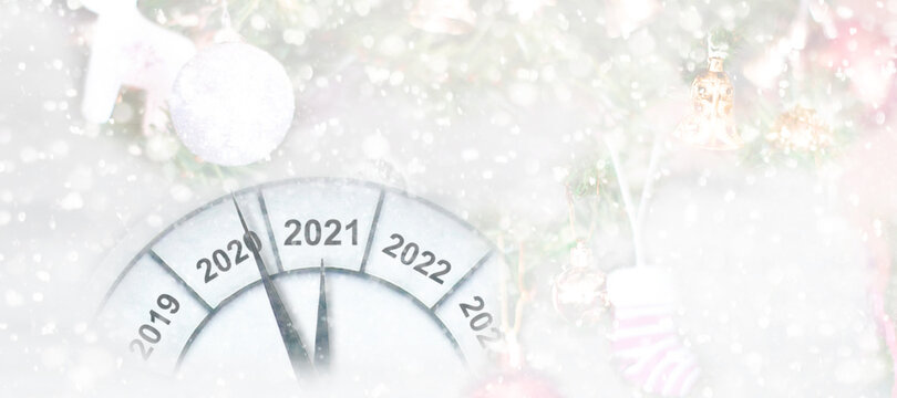 Countdown to midnight. Clock of holiday counting last moments before Christmas or New Year 2021.