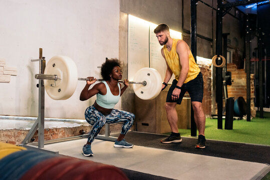 Portrait of Afro American Woman Using Barbell