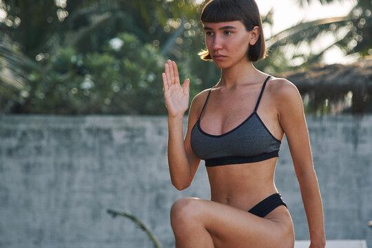 strong woman doing yoga exercise