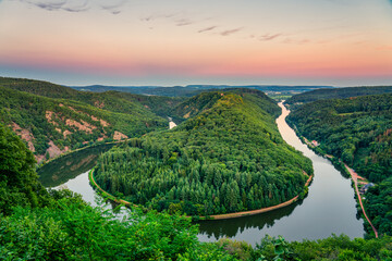 Saar river valley panorama near Mettlach viewed at sunset. South Germany