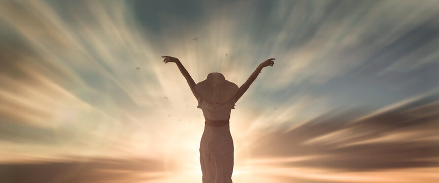 Silhouette woman with hands rise up on beautiful view. Christian praise on hill thanksgiving day background. support nature standing open arms enjoying sun concept jesus fun world wisdom 2020