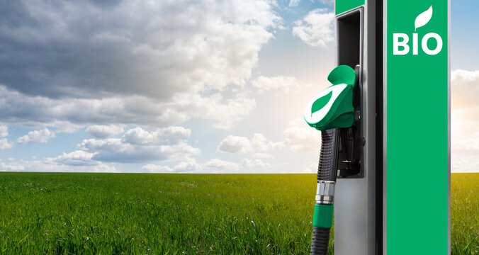 Biofuel filling station on a background of green field and blue sky