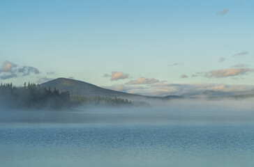Fotomurales - Fog over a lake in Sweden during a summers morning.