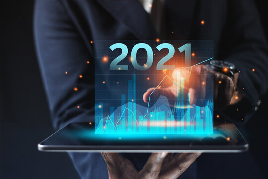 Business people touch graphics technology To analyze the income of the organization Through the laptop of the overall picture of the year Business assessment ideas in 2021