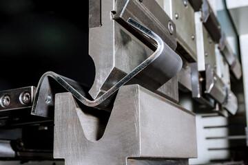 Fototapeta The process of bending sheet metal on a hydraulic bending machine