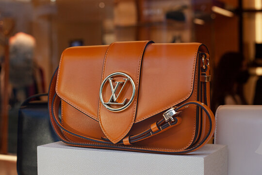 LV brown shoulder bag. Louis Vuitton bag on windows display. Moscow, Russia - December 2020.