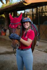 Fototapeta Chica hipica montando a caballo ecuestre en club de monta caballo andaluz cadiz doma clasica vaquera obraz