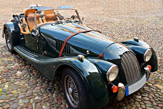 Morgan Plus car in green color. The Morgan Motor Company is a historic British car manufacturer that has handcrafted a small number of sports cars in the retro line