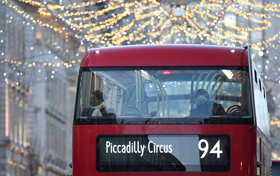 Bus passengers look out at Christmas lights ahead of new restrictions amid the spread of the coronavirus disease (COVID-19), in London