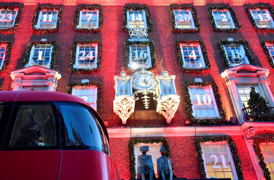 A passenger looks out as the bus passes the seasonal display of a retail store ahead of new restrictions amid the spread of the coronavirus disease (COVID-19), in London