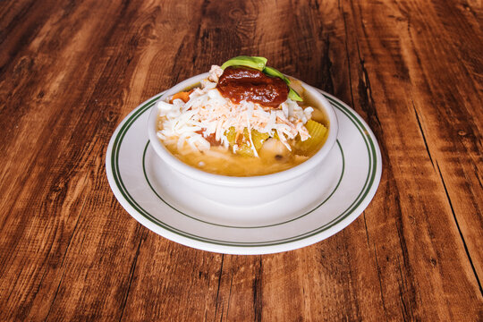 Mexican chicken soup topped with cheese