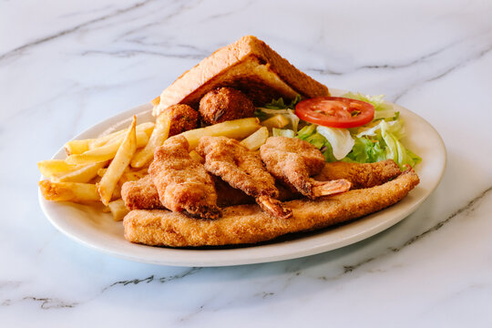 Mexican food fried fish with fries