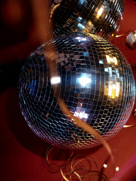 disco ball with gold streamers